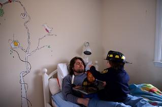 reading to dad | by Veronique Christensen