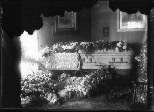 Mrs. S. Nesselhauf in casket covered with flowers 1915 | by Miami U. Libraries - Digital Collections