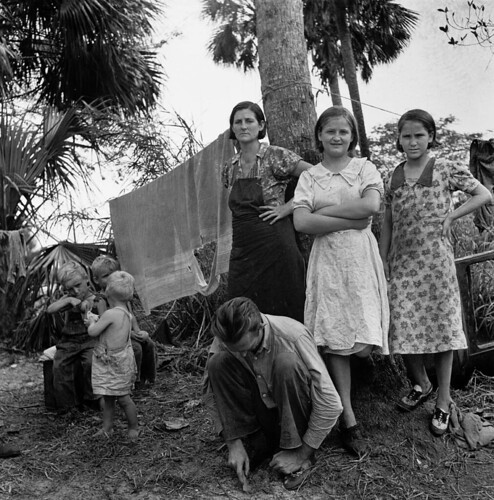 "Marion Post Wolcott: Migrant family from Missouri camping out in cane brush. One woman said, ""We ain't never lived like hogs before, but we sure does now."" Canal Point, Florida, 1939"