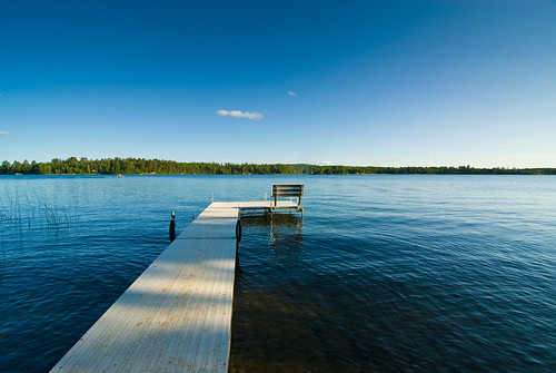 blue sky house lake water minnesota dock cabin calm
