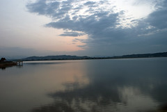 Sunrise at Rawal Lake under dark clouds