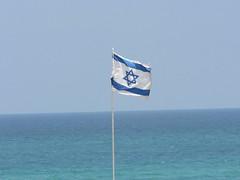 Flag of Israel in Rishon LeZion beach   by Zachi Evenor