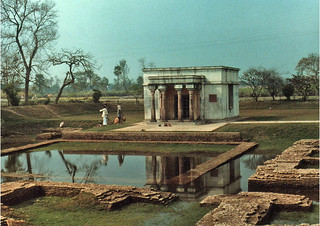 Building commemorating the location of 1st centruy Matakuwar Temple where Buddha drank water for the last time, tank of reflecting water, Kushinara, India 1986