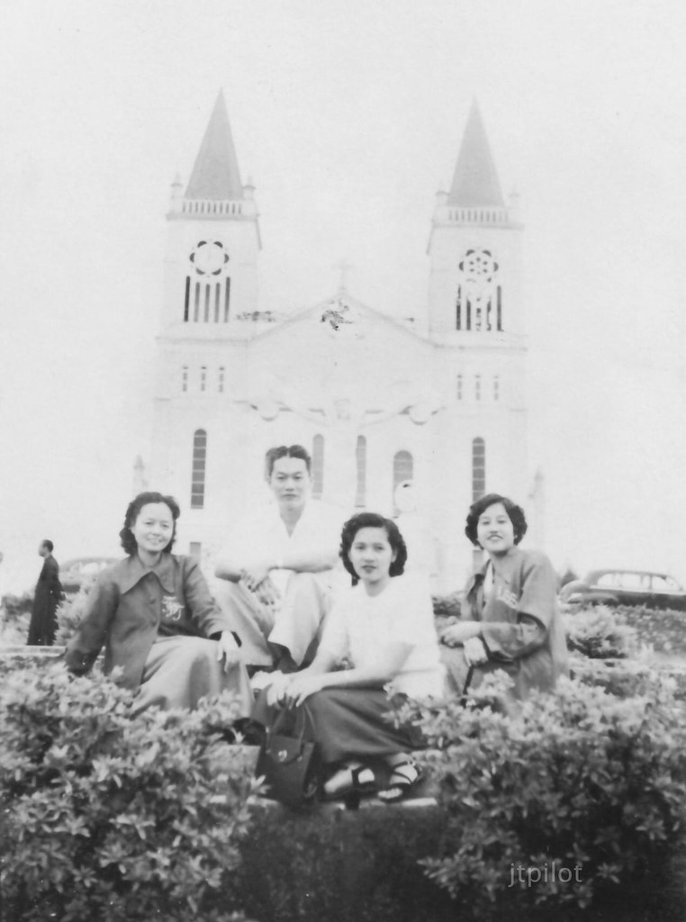 Baguio Cathedral, a group of four in front, unknown date.  I would guess late 1940s or 1950s