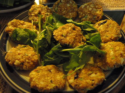 "cashew ""burgers"" on a bed of arugula 