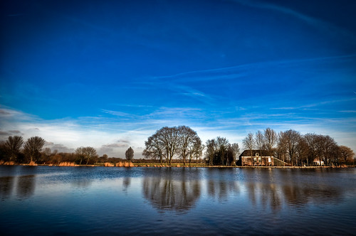 blue winter sky cold tree water amsterdam clouds reflections river landscape skies thenetherlands clear temperature 1020mm amstel amstelveen celcius abigfave impressedbeauty goldstaraward