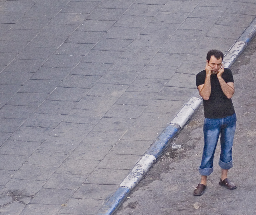 A GUY WITH CELL PHONE