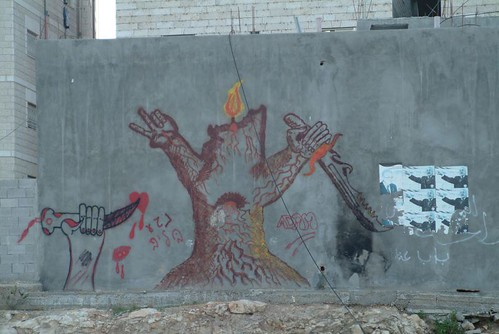 Drawings on the separation wall between Israel and Palestine, From CreativeCommonsPhoto