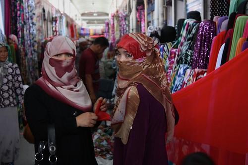 Uyghur women shopping in the bazar, Kashgar, Xinjiang