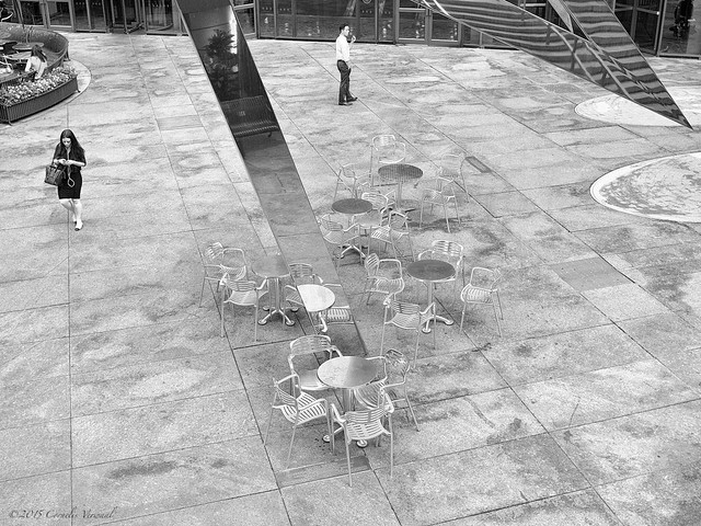 A Symphony of Chairs and Little Tables