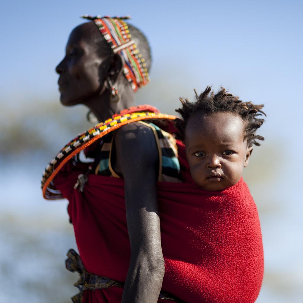 Samburu mother carrying her baby on her back - Kenya