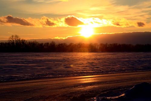 sunset longlight clouds snow ice winter ruralohio sky trees coldfront handheld eriecounty rays