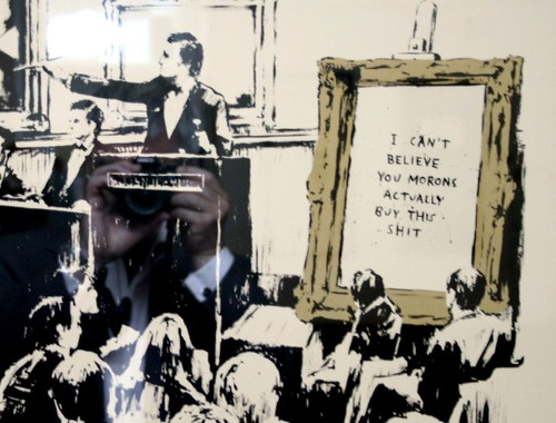 "Banksy ""I can't believe you morons actually buy this shit"" at the free exhibition of his work in Covent Garden 