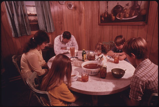 The Wayne Gipson Family Says a Prayer before Their Evening Meal in the Kitchen of Their Modern Home near Gruetli, near Chattanooga, Tennessee 12/1974   by The U.S. National Archives