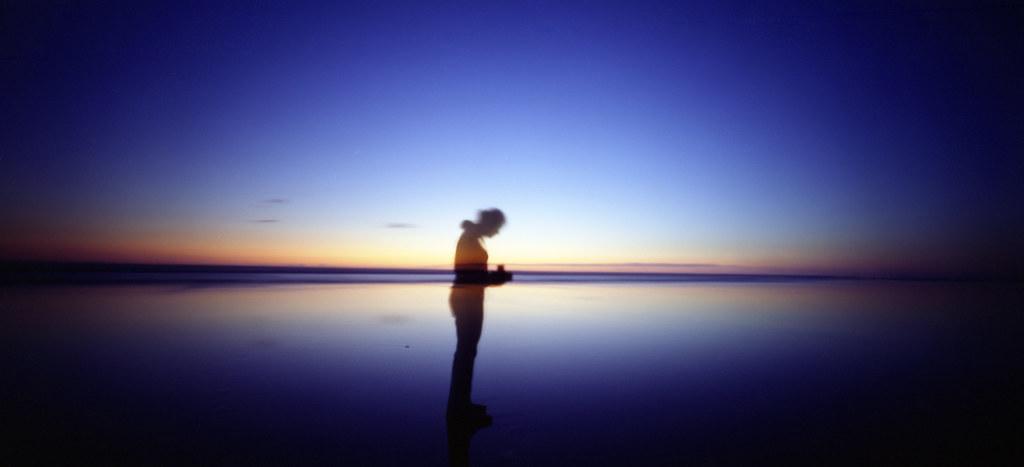 a silhouetted self portrait along the oregon coast