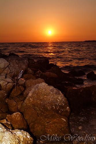ocean travel sunset sky orange usa sun reflection beach water sunrise canon tampa photography photo sand nikon rocks fuji gulf tampabay florida tide horizon picture photograph fl apollo tidal hillsborough mikewoodfin