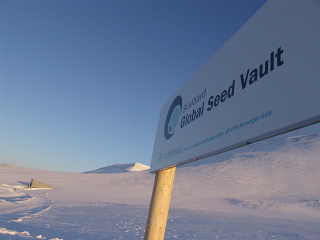 Svalbard Global Seed Vault Sign with the Vault in the Background