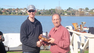 David Barker receiving 2009 Barbecue Trophy for most improved Sailor | by PLSC (Panmure Lagoon Sailing Club)