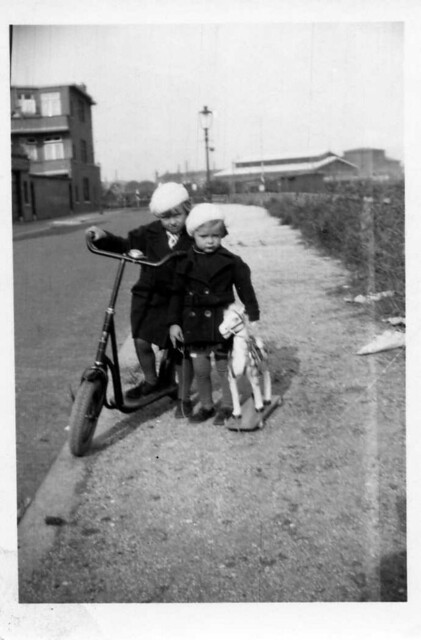 Martha (with scooter , 'step') and Paula ten Wolde (with toy-horse , close to 'rocking-horse' ) , two little , dear , inseparable sisters , portrayed here somewhere in the Rivierenbuurt in their home-town The Hague/Den Haag in the Netherlands , 1930's