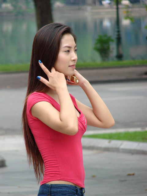 Young Woman in Public Plaza - Hanoi - Vietnam