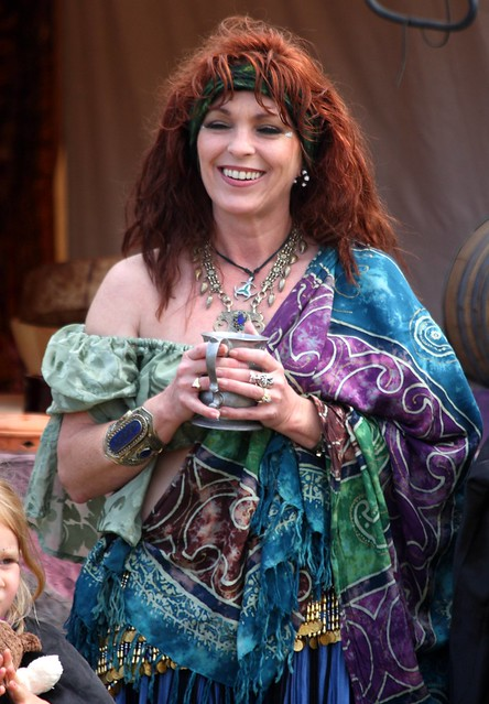 Lovely multi-colored belly dancer in the Wild Rovers camp