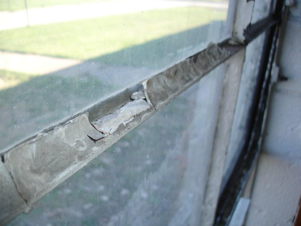Asbestos Window Glazing Compound - Damaged | Example of dama