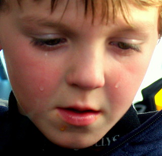 A boy crying because he is sad his hot dog fell | by david_shankbone