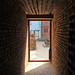 A doorway that leads to a courtyard in Kathmandu