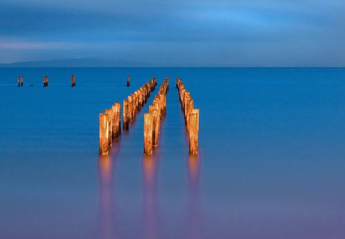 ocean blue sea reflection beach night clouds canon landscape washington seaside lowlight marine tide piling tidal pointroberts hmb blueribbonwinner abigfave colourartaward goldstaraward rubyphotographer paololivornosfriends