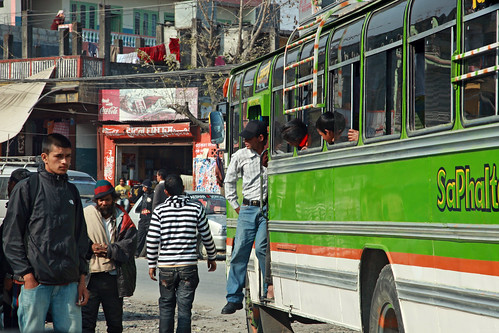 A passenger disembarks from a bus | by World Bank Photo Collection