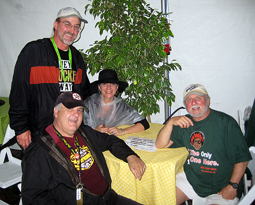 Coach Bill Babcock (standing), A.J. Rodrigue, and Billy Delle in the 'OZ Hospitality Tent. (Photo by Sally Young)