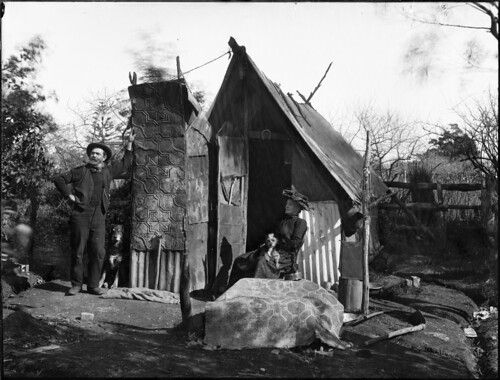 A man and woman outside a bush hut | by Powerhouse Museum Collection