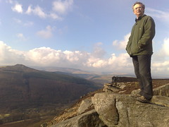 Dad at Bamford edge with win hill in the distance