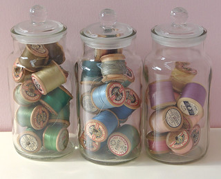 Vintage threads stored in glass jars | by freudianslipsvintage