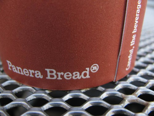 panera bread paper coffee cup on wire table | by stevendamron