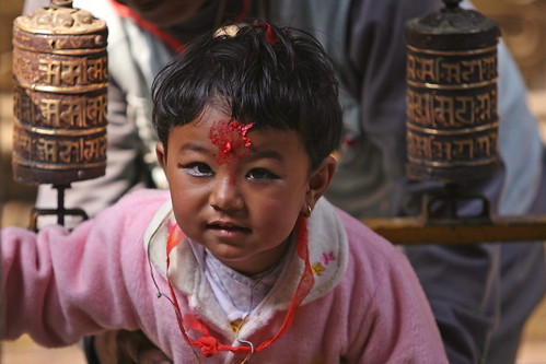Young girl at Buddhist temple   by World Bank Photo Collection