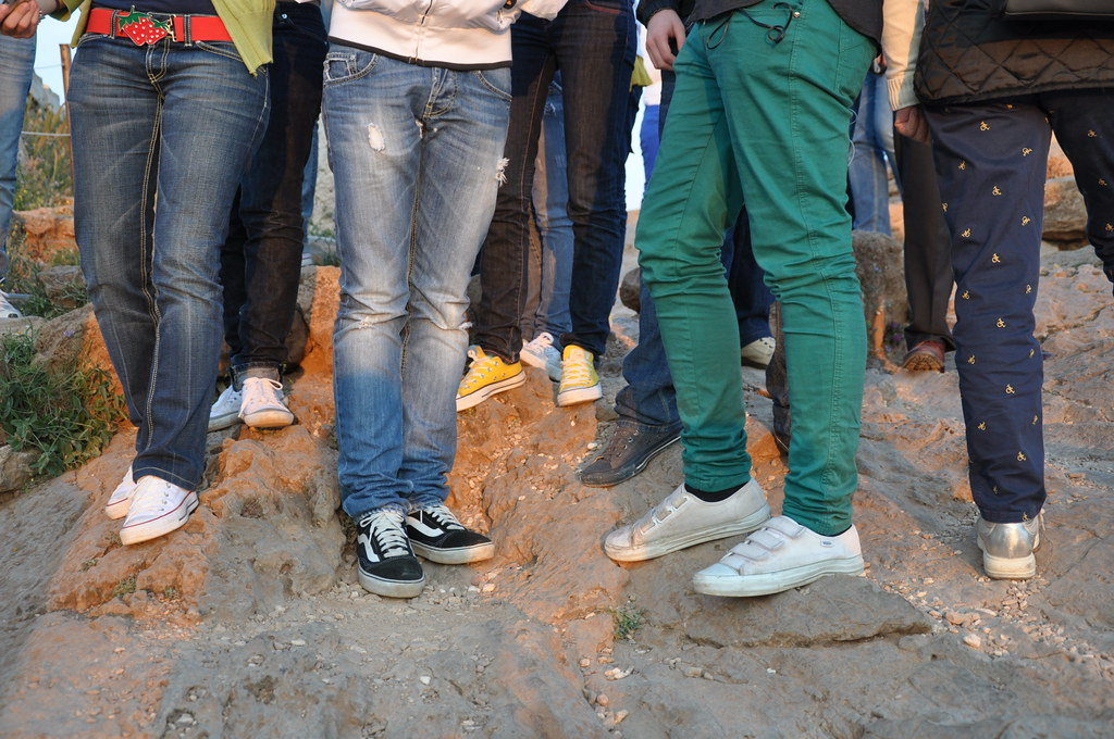 Italian teenagers like skinny jeans and sneakers.