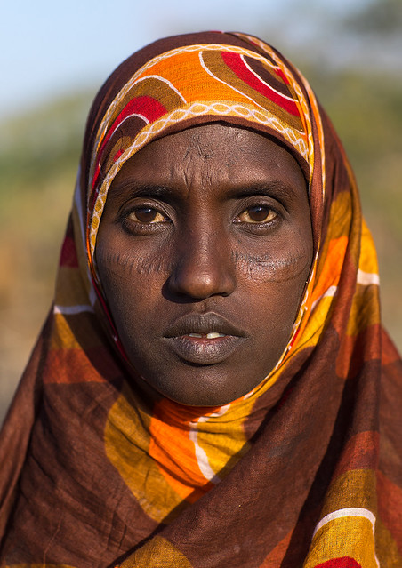 Afar tribe woman with scarifications on her face, Afar region, Afambo, Ethiopia