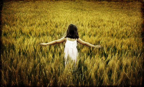 girl field back open arms little wheat daughter theghostofaflea