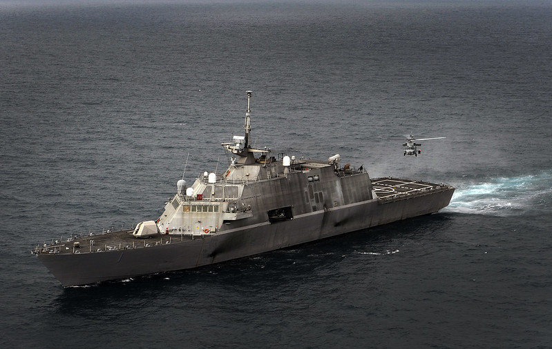 An MH-60R Sea Hawk helicopter prepares to land aboard the littoral combat ship USS Freedom (LCS 1).