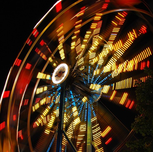 longexposure carnival blue atlanta red summer usa motion blur colors yellow night contrast dark georgia lights moving lowlight nikon ride nightshot unitedstates south spin roswell wideangle explore southern exposition squareformat ferriswheel rides bigwheel 2008 rotating amusements turning explored d80 expowheel mywinners focallength26mm peachtreerides nikkor1855mmf3556gvr aperturef42 roswellmall exposure06sec