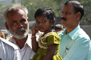 Little girl in her father's arms   by World Bank Photo Collection