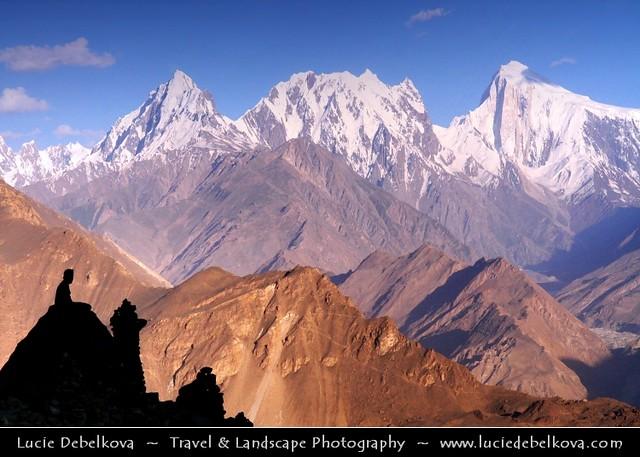 Pakistan - Lonely traveler overlooking Karakoram Range
