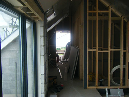 <p>Demolish garage,build new garage with bedroom above. Takedown exsisting first floor.Rebuild first floor and roof. Extensive alterations. Transformed 1930 bungalow into contempory house.</p>