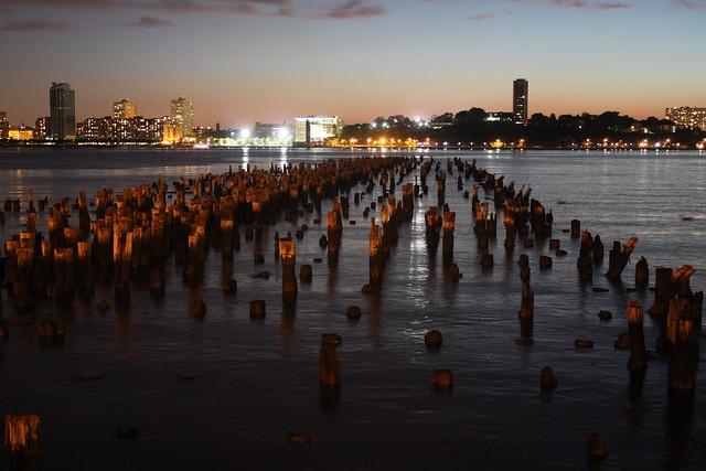 new york city downtown hudson river water sticks