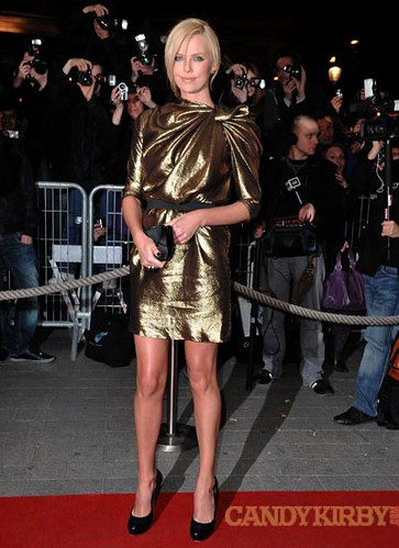 5a2340766361 Charlize Theron in a Bronze Dress at the