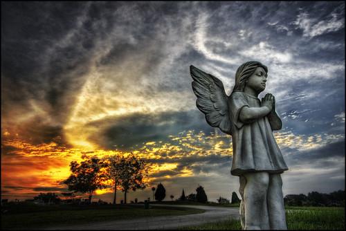 blue sunset sky sculpture orange tree green cemetery grave angel peace pray tomb tombstone dramatic christian gravestone hdr cck 5exp darrellneo