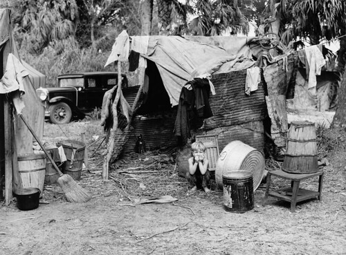 Marion Post Wolcott: Child in Doorway of Shack of Migrant Pickers and Packing House Workers, near Belle Glade, Florida, 1939