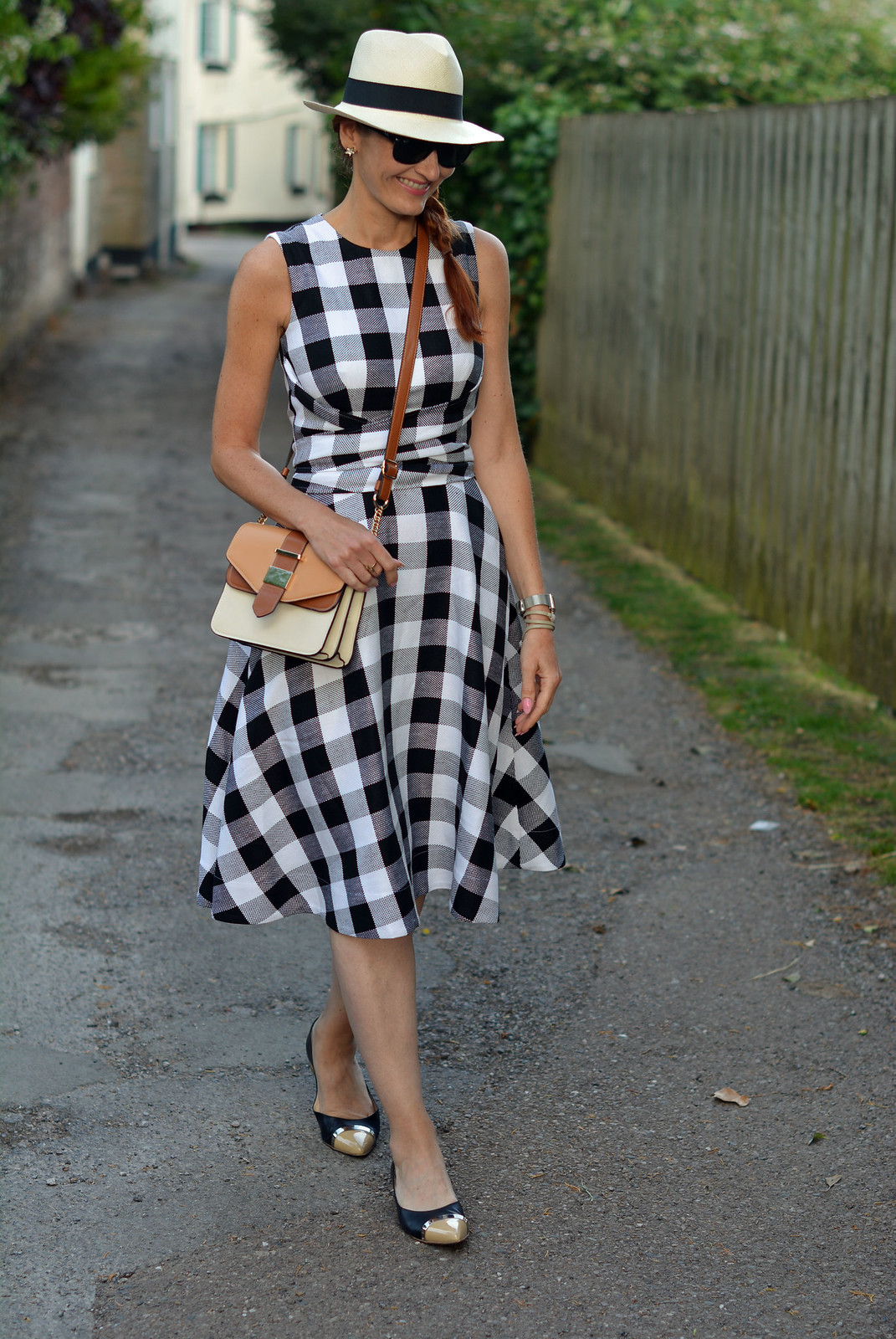 Not Dressed As Lamb | Fit-and-flare black and white gingham dress, Panama hat, pointed flats