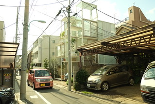 kei car passing by sou fujimoto's transparent multi-level house (tokyo) | by nicolas.boullosa